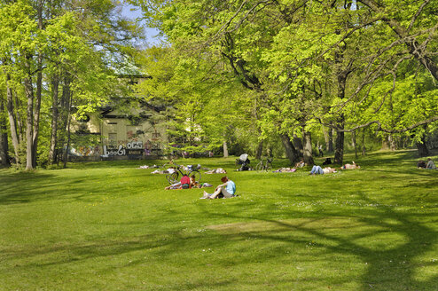 Germany, Bavaria, Munich, people sunbathing in park - MBF00764