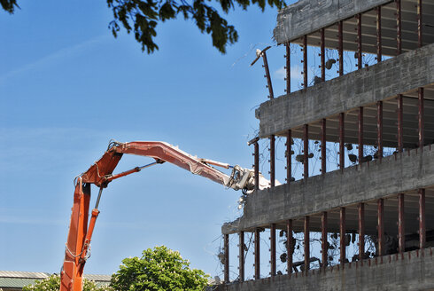 Germany, Bavaria, Munich, crane knocking off building - MB00753