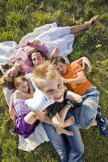 Family lying in meadow - LDF00552