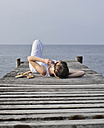 Italy, Lake Garda, Young woman (20-25) using phone - DKF00122