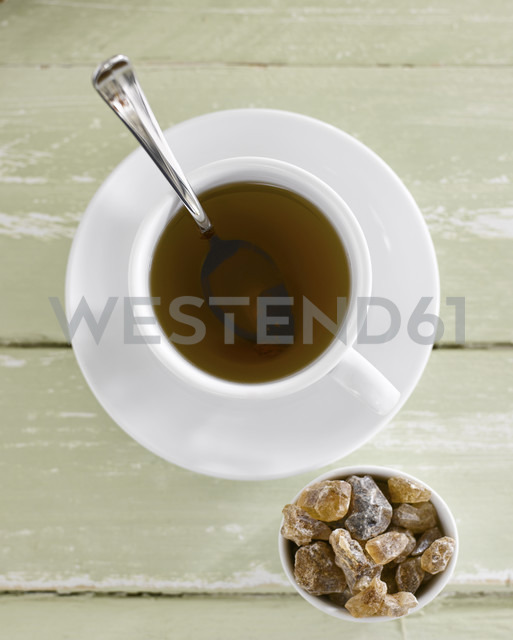 Cup of tea with candy, elevated view - KSWF00030