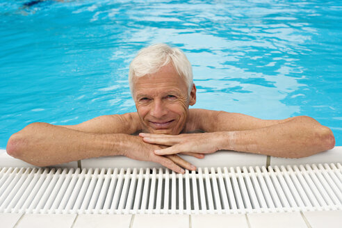 Germany, senior man relaxing in pool, close-up, portrait - BABF00263