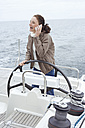Young woman at ship's wheel - BAB00451