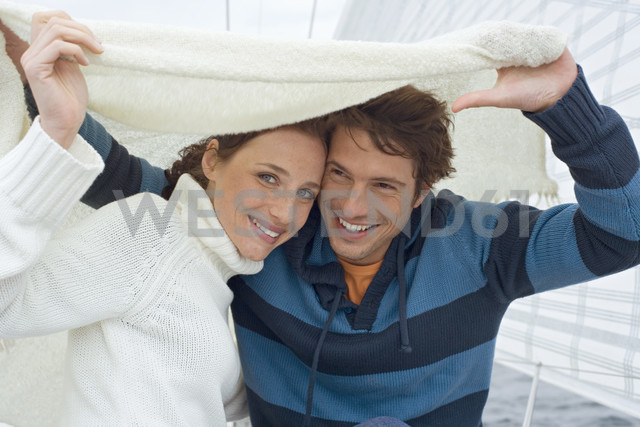 Germany, Baltic Sea, Lübecker Bucht, Young couple on sailing boat, portrait - BAB00442