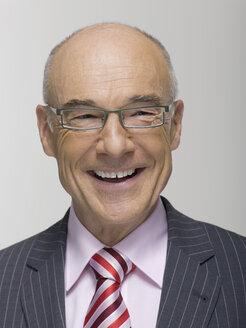 Senior businessman, portrait, smiling - WESTF06530