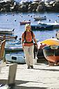 Italy, Liguria, Woman in Riomaggiore - MRF01035