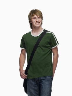 Teenage boy (16-17) smiling, portrait - KMF01144