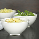 Asparagus, mushed potatoes and salad in white bowls, close-up - CHK00862
