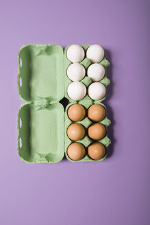 White and brown eggs in box, elevated view - MNF00117