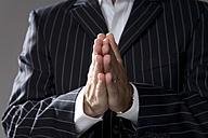 Man making hand gesture, praying, close-up - MAEF00765