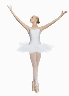Young ballerina (14-15) standing on pointe in toe shoes,, portrait - KMF01162