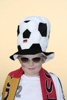 Boy (10-13), soccer fan, portrait - HKF00101