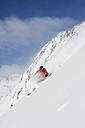 Austria, Tyrol, Stubai valley, man skiing - FFF00885
