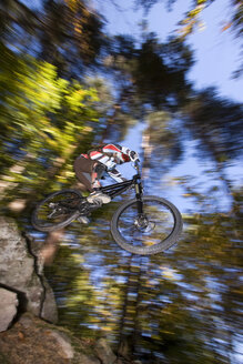 Italy, Southern Tyrol, man mountain biking - FFF00847