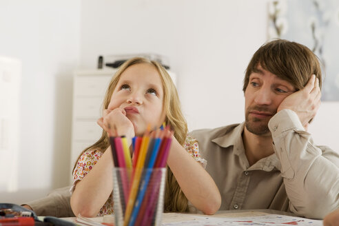 Father and daughter (8-9) doing homework - WESTF07319