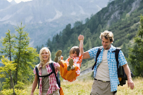 Austria, Salzburger Land, couple with son (8-9) hiking - HHF01807