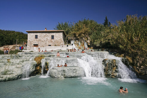 Italy, Tuscany, Saturnia, Group of people enjoying in a hot spring - FOF00566