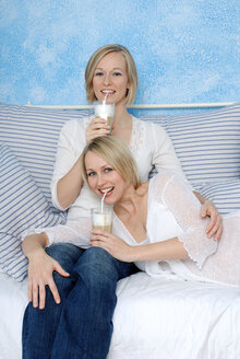 Two blonde women drinking white coffee, portrait - DKF00145