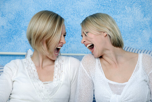 Two blonde women fooling about, portrait - DKF00142