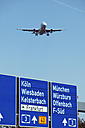 Germany, Frankfurter Kreuz, Airplane over freeway - TH00662