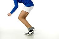 Female teenager in sportswear, low section - NHF00741