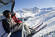 Switzerland, Graubuenden, Savognin, Children's (8-9) in ski lift - WDF00033