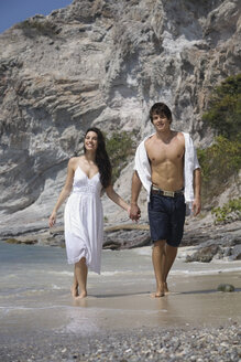 Asia, Thailand, Young couple walking hand in hand along beach - RDF00654
