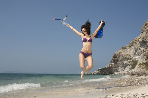 Asia, Thailand, Young woman jumping on beach - RDF00647