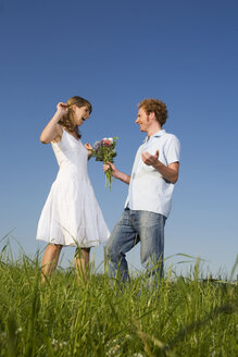 Germany, Bavaria, Young couple, man with bouquet - RDF00539
