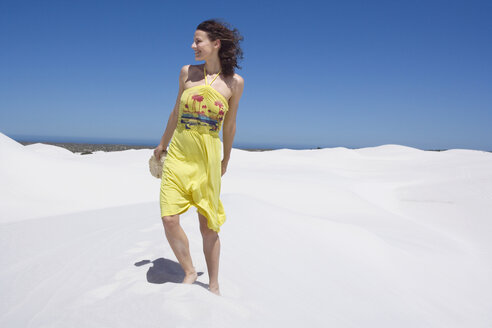 South Africa, Cape Town, Young woman in sand dunes - ABF00374