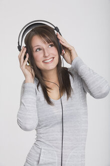 Young girl with headphones listening to music - RDF00832