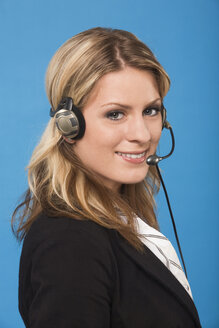 Young woman wearing a headset, portrait - RDF00776