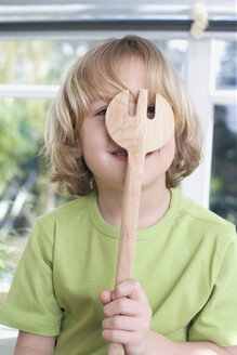 Portrait of a boy (8-9) with wooden fork - WESTF08286