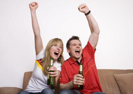 Soccer Fans watching Soccer Game on Television - GAF00014