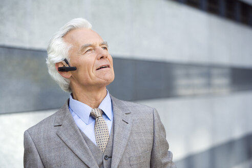 Germany,Baden Württemberg, Stuttgart, Senior Business man wearing headset - WEST08420