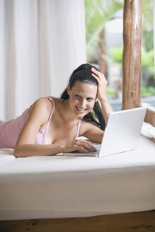 Young woman in underwear using laptop - ABF00349