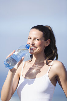Young woman drinking water, portrait - ABF00331