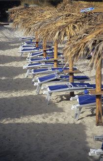 Italy, Sardinia, Deck chairs on Beach - LFF00118