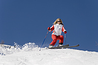 Austria, Salzburger Land, Altenmarkt- Zauchensee, Young woman skiing - HH02489