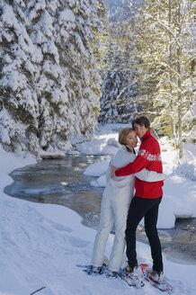 Austria, Salzburger Land, Altenmarkt-Zauchensee, Young couple in snowshoes - HH02532