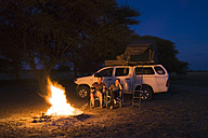 Africa, Botswana, Two persons by camp fire - FOF00733