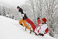 Austria, Salzburger Land, Altenmarkt-Zauchensee, Young man pulling woman on sledge - HH02537