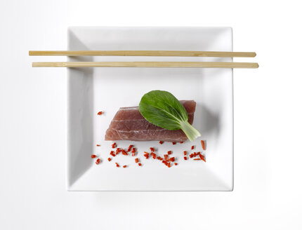 Uncooked tuna with chili pepper and  Chinese celery cabbage, elevated view - KSWF00143