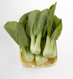 Bok choy, Chinese celery cabbage on chopping board - KSWF00171