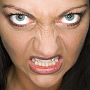 Woman's face, snarling, close-up, portrait - MUF00581