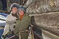 Austria, Salzburger Land, Altenmarkt, Young couple taking a break at cabin - HH02605