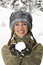 Austria, Salzburger Land, Altenmarkt, Young woman presenting snowball - HH02575