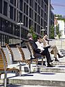 Germany, Baden-Württemberg, Stuttgart, Businesspeople with laptops, taking a break - WEST08618