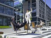 Germany, Baden-Württemberg, Stuttgart, Businesspeople taking a break, woman cheering - WEST08615