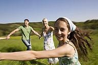 Germany, Baden Württemberg, Tübingen, Family dancing in meadow - WESTF08960